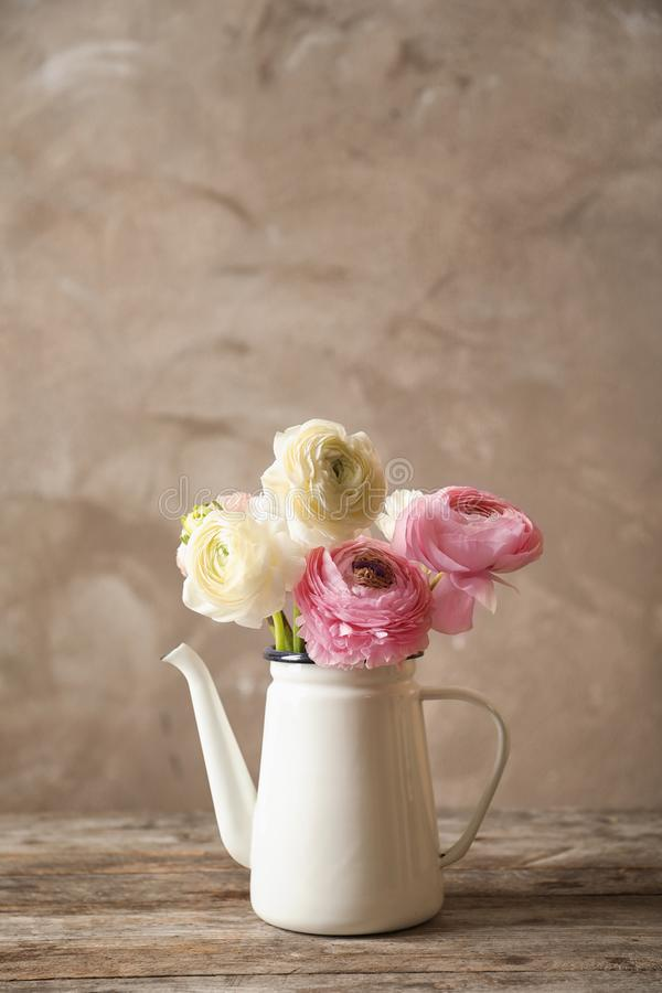 Vase with beautiful ranunculus flowers stock photography