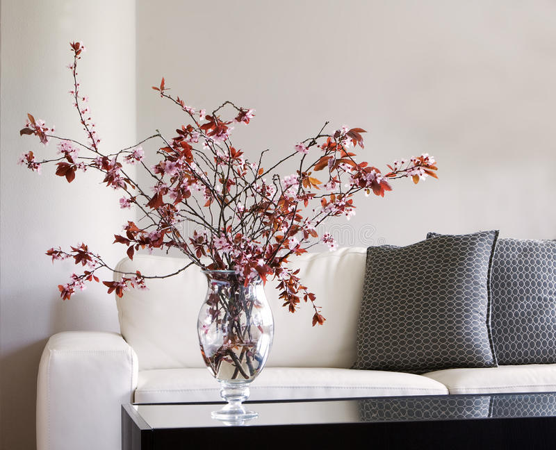 Living Room Vase vase of blossoms on table in modern living room stock photography