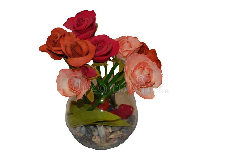 Vase with a bouquet of rose flowers close up on a white background stock photography