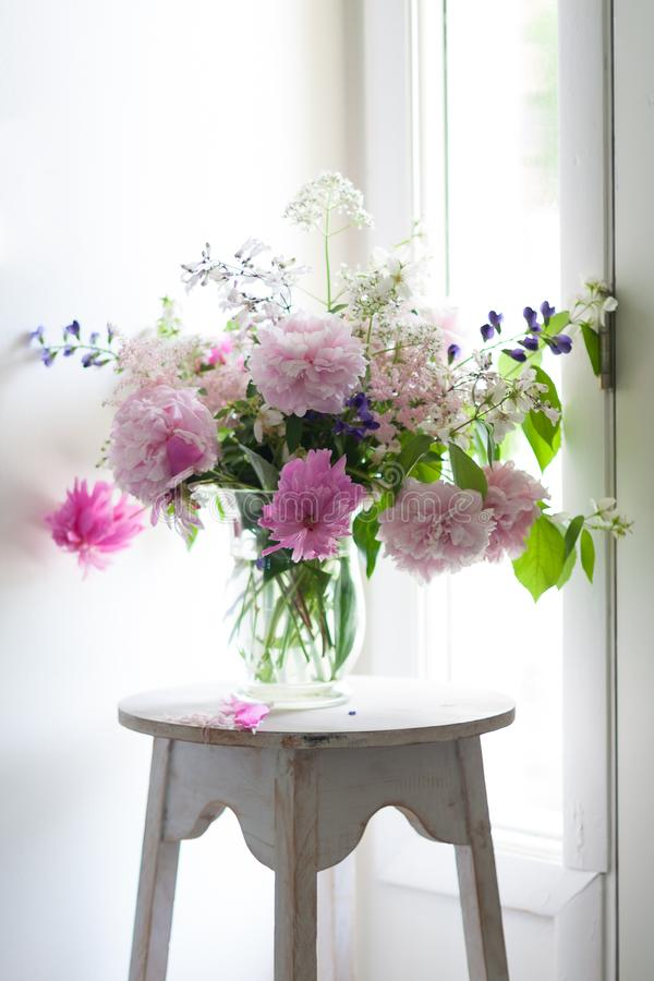 Vase of Colorful Flowers in Glass Vase stock image