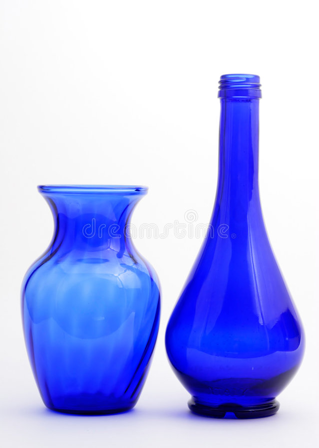 Vase et bouteille bleus photos stock