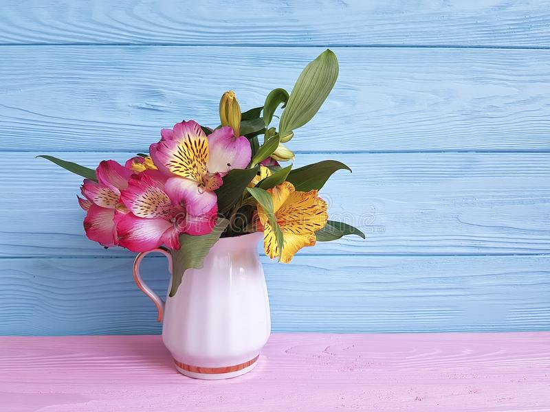Vase flower alstroemeria seasonal on a wooden arrangement stock images