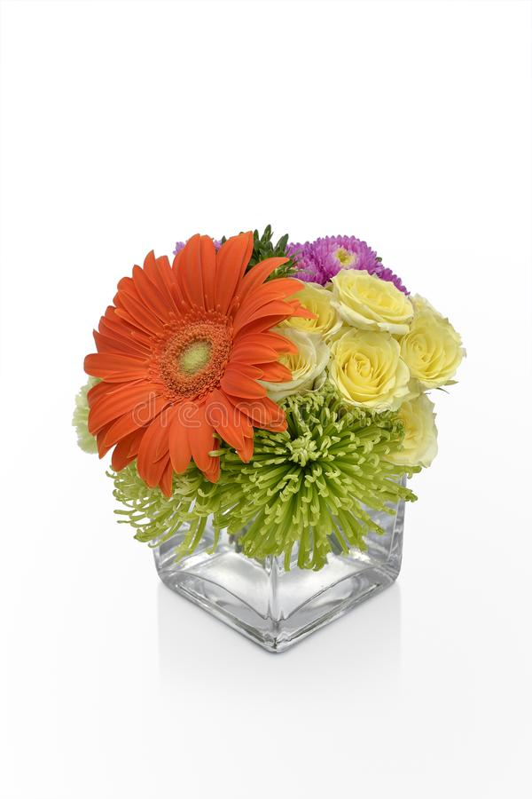 Gerbera Daisy flower arrangement in a vase with yellow Roses. Floral vase arrangement by a florist. royalty free stock photography