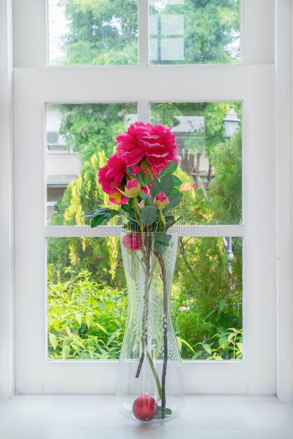 Vase with a flower on the windowsill country house.  stock image