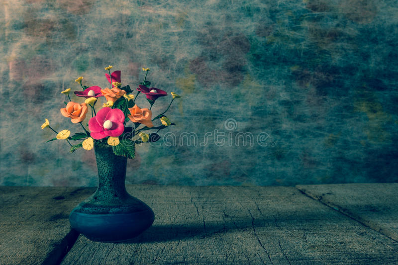 Vase flower with wooden platform,light vintage tone filter proce stock image