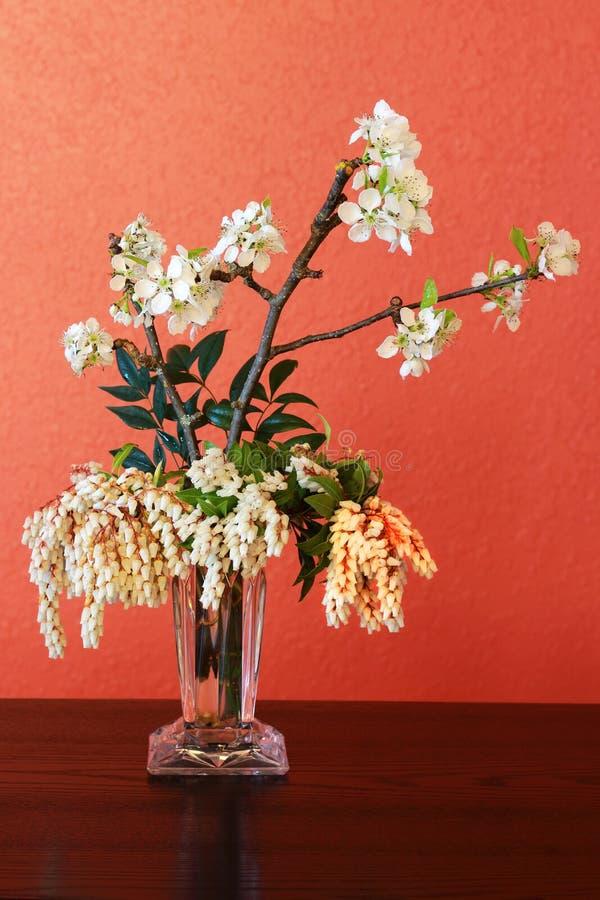 Vase of flowers. A glass vase full of garden blossoms stock images
