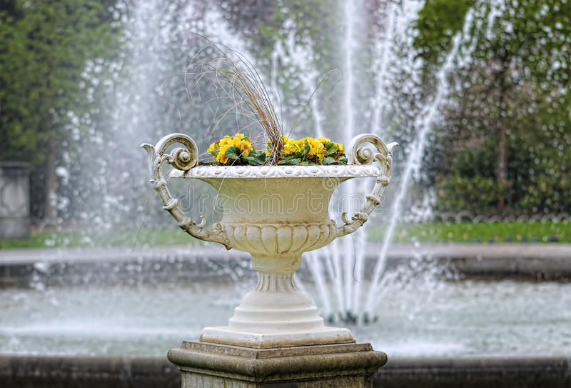 Download Vase With Flowers In City Garden Royalty Free Stock Images - Image: 30134599