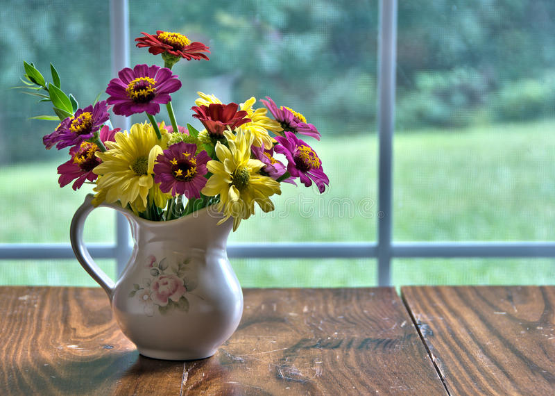 Vase of freshly cut flowers royalty free stock photos