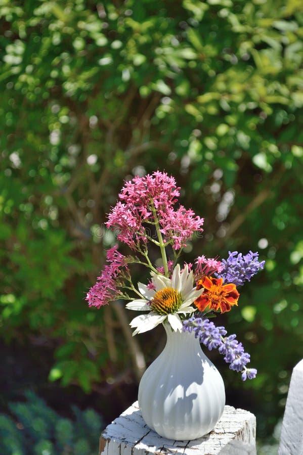Vase with Marigold, Valerian, Lavender, White Coneflower royalty free stock photography