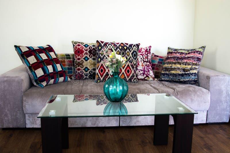 Vase in modern white living room - home decor. Blue vase and sofa in modern white living room - home decor royalty free stock images