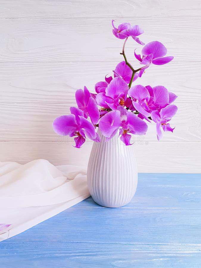 Vase orchid bouquet flower decor on wooden background stock photography