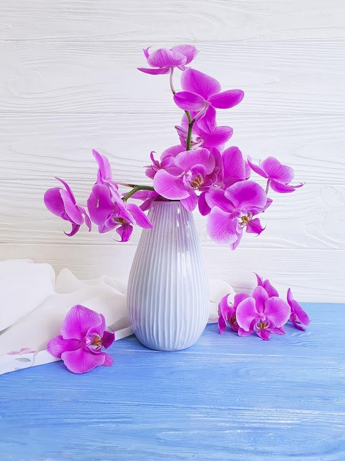 Vase orchid bouquet flower vintage decor on wooden background stock photos