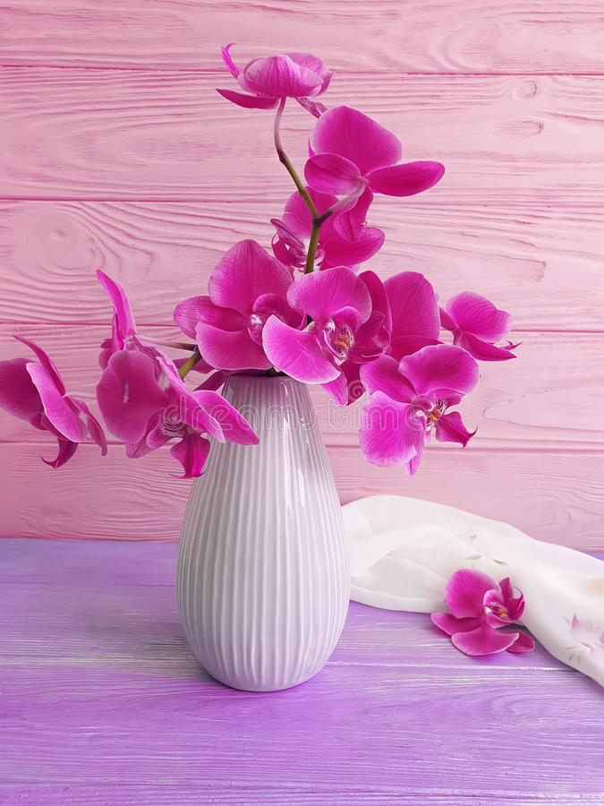Vase orchid bouquet flower on wooden background stock images
