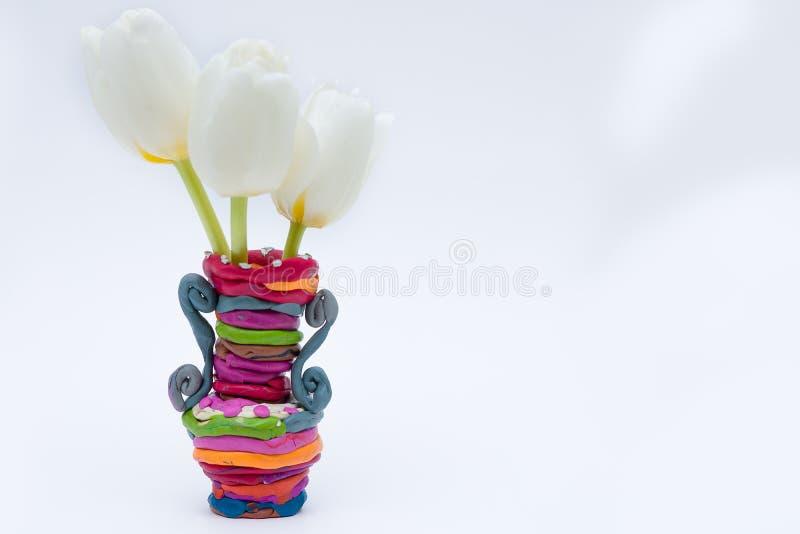 Vase with three white tulips royalty free stock photo