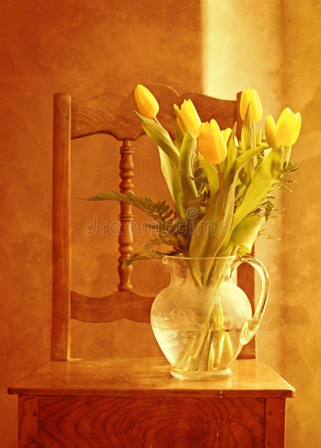 Vase of tulips on table royalty free stock images