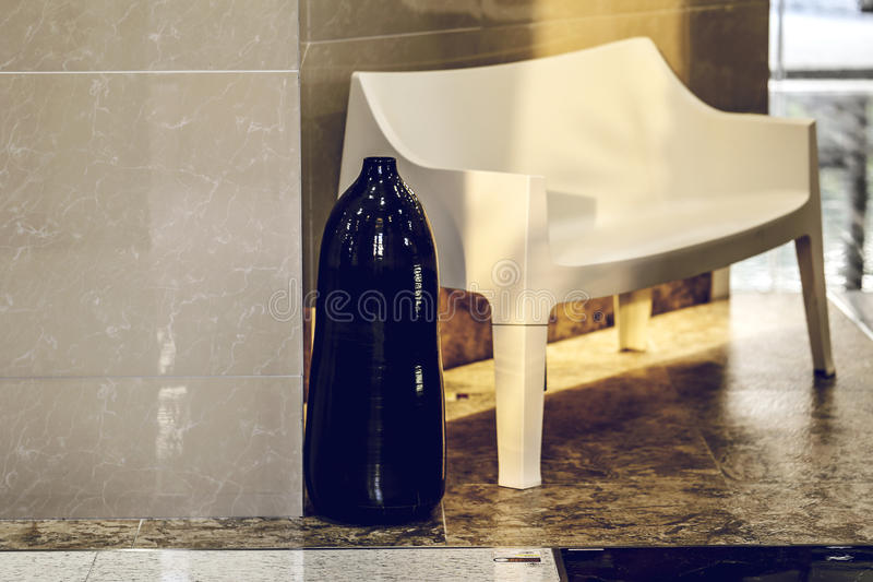 Vase with white chair in interior living room with wall marble for copy space. Minimal interior. Perfect for your presentations stock image