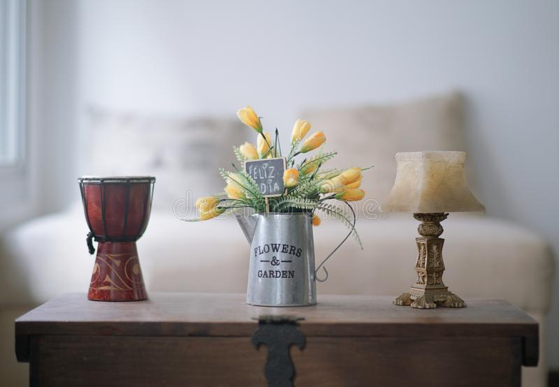 Vase with yellow and green flowers , with a card that says happy day stock photos
