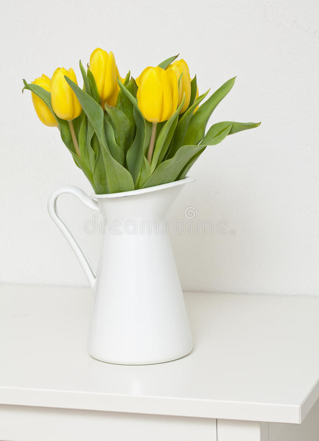 Vase With Yellow Tulips Royalty Free Stock Photos