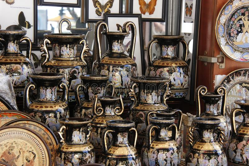 Vases in ancient greek style for sale on display. With handles and golden metallic effect paint royalty free stock image