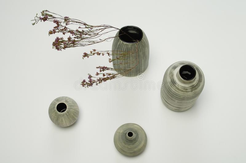 Vases with dried flowers stock photo