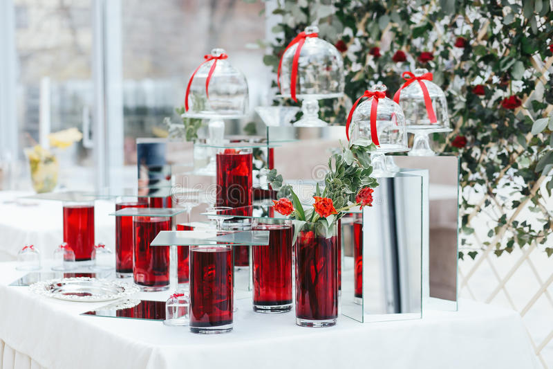 Vases with red water and roses as a part of wedding decoration stock download vases with red water and roses as a part of wedding decoration stock image junglespirit Image collections