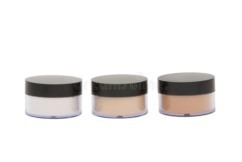 Vasi cosmetici con polvere isoleted nel bianco immagine stock