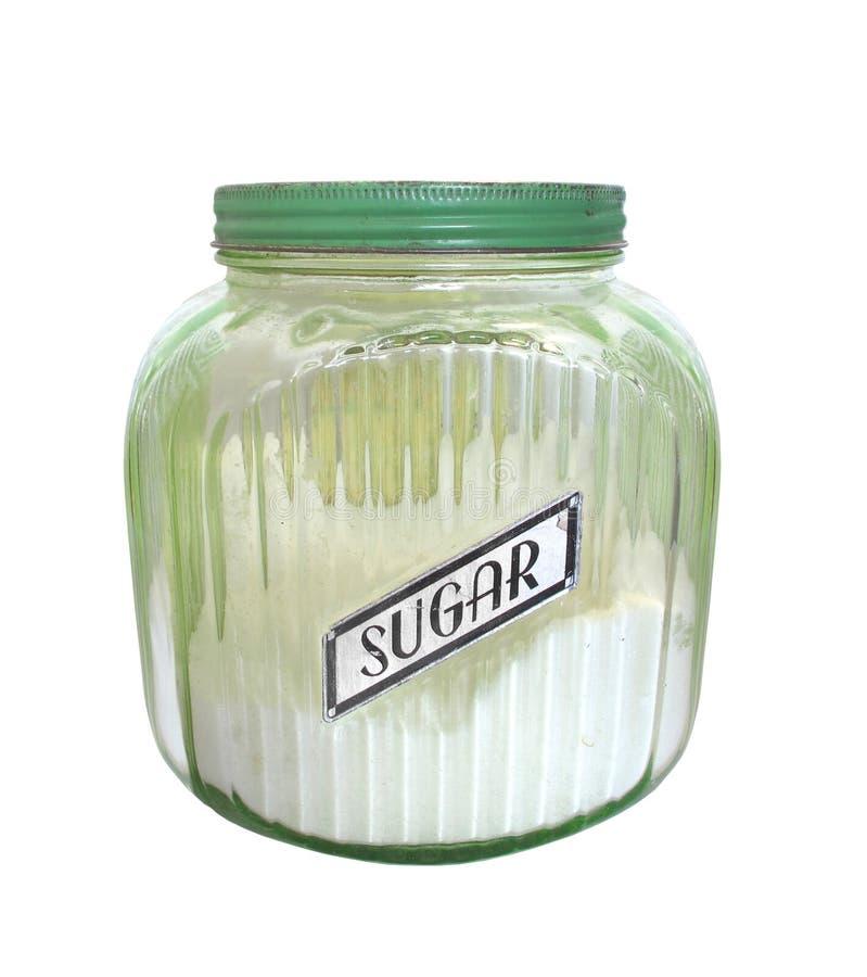 Vaso dello zucchero di vetro verde dell'annata isolato. fotografia stock