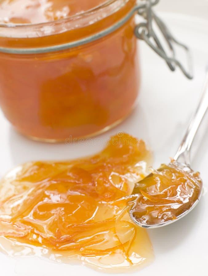 Vaso di marmellata d'arance fotografie stock libere da diritti