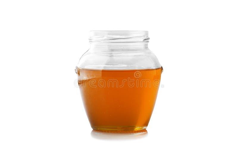 Vaso di vetro di miele fotografia stock libera da diritti