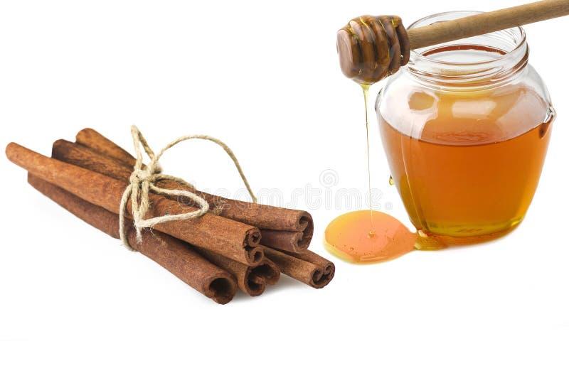 Vaso di vetro di miele immagini stock