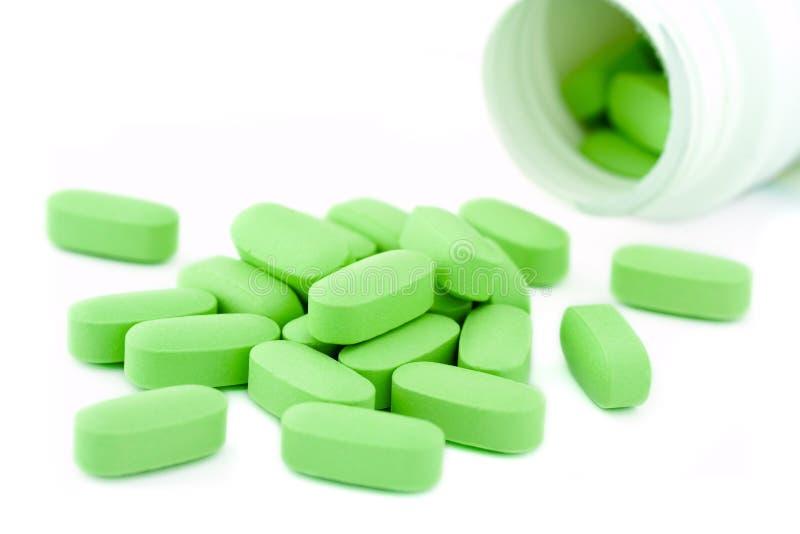 Vaso e pillole della medicina fotografia stock libera da diritti