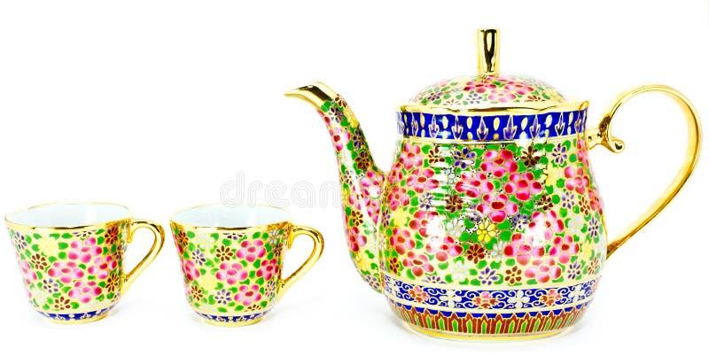 Vaso tailandese del tè e due tazze fotografie stock