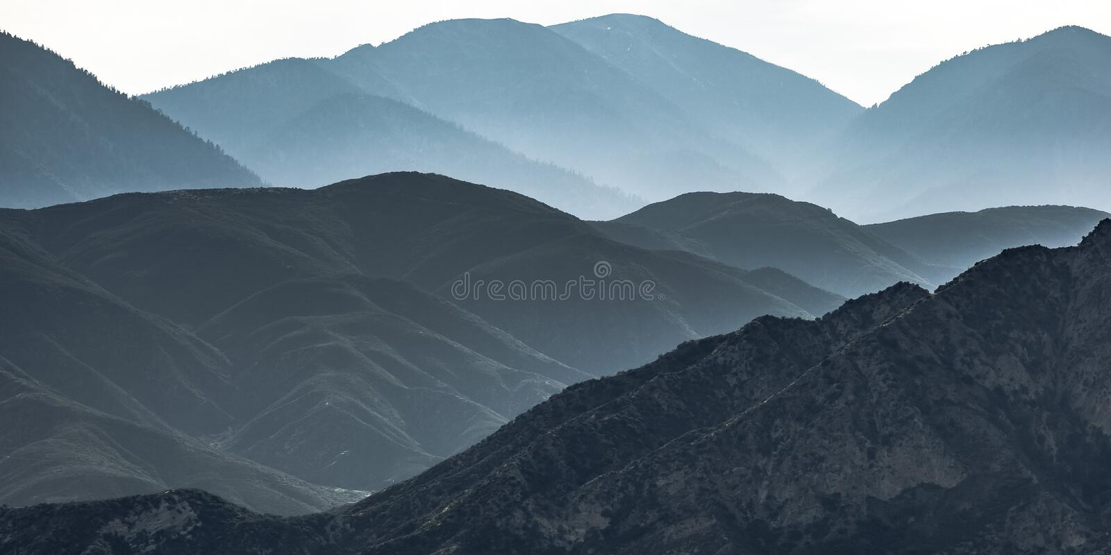 Vast mountain ridge in Ontario California in haze stock photography