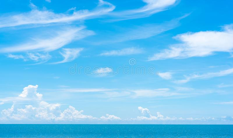Vast sky space with summer clouds above the stripe of the sea with the horizon stock photos