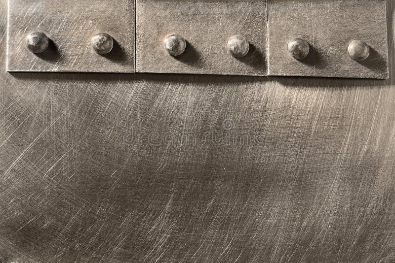 Vastgenagelde naad op het metaal stock fotografie