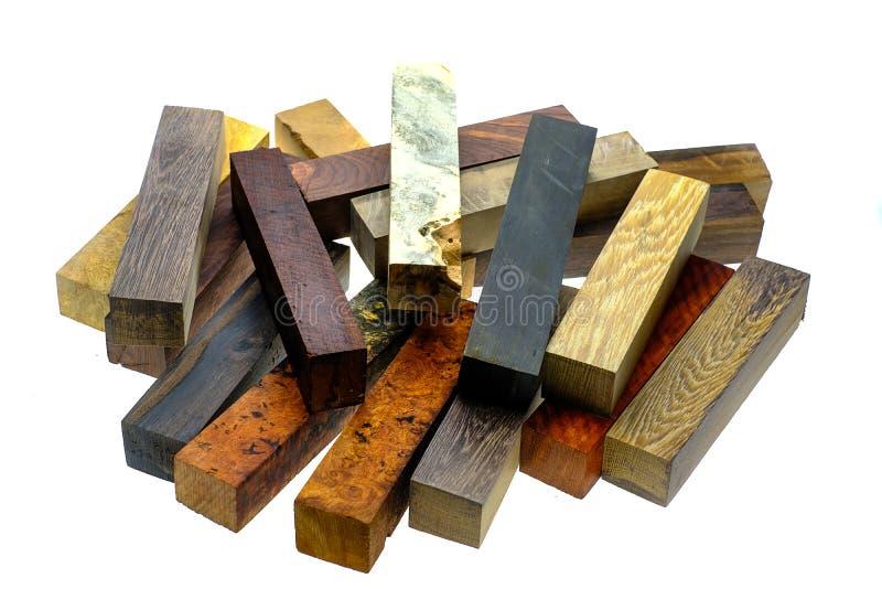 Vastgestelde Exotische houten echt voor spatiespen op witte achtergrond stock fotografie