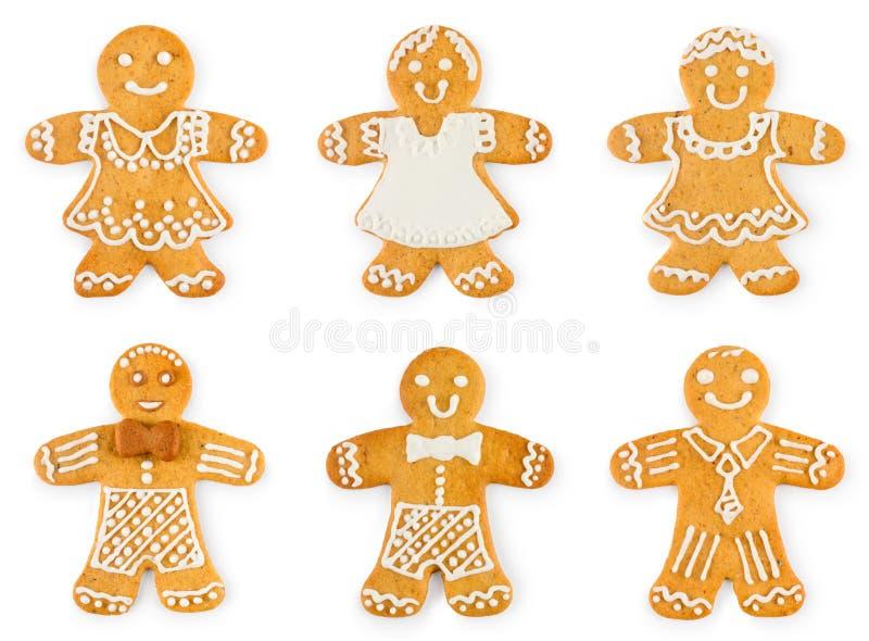 Vastgestelde peperkoekenjongens en meisjes - Kerstmis zoete koekjes stock afbeelding