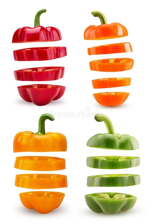 Vastgestelde plakken oranje, rode, groene, gele groene paprika die in vliegen stock foto's