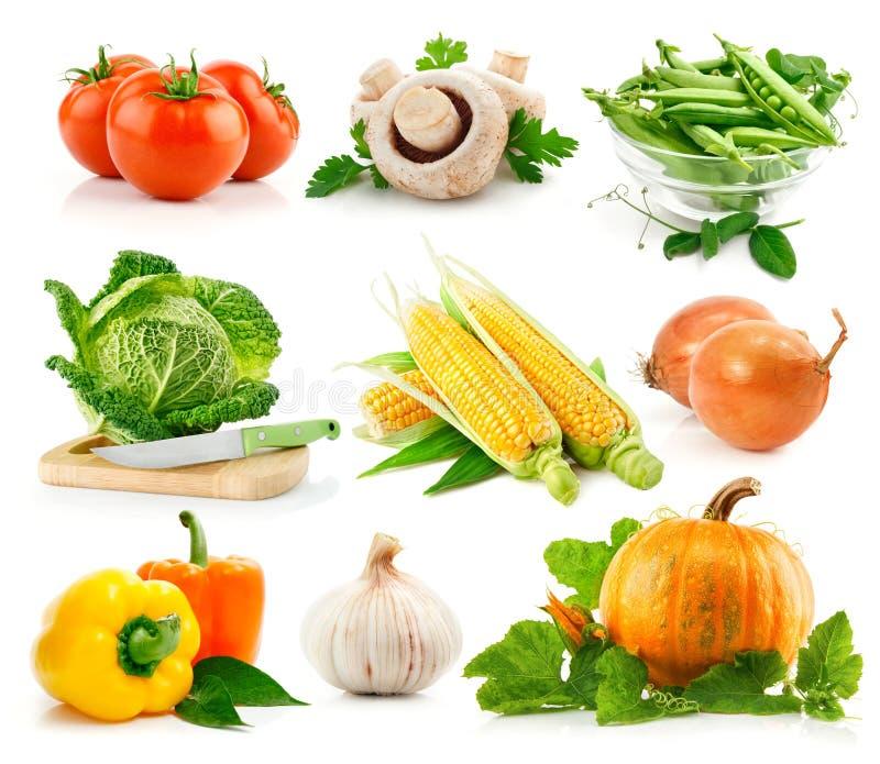 Vastgestelde verse groenten met groen verlof stock fotografie