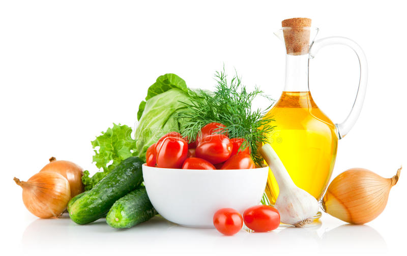vastgestelde verse groenten met olijfolie stock afbeeldingen