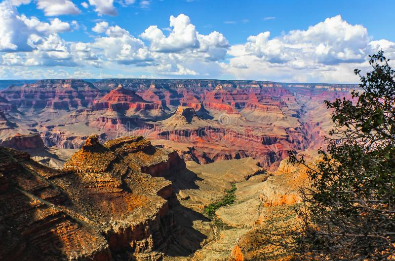 The vastness of the Grand Canyon - View from South Rim at the worlds held in this one majestic canyon with its mesa and rivers and royalty free stock photo