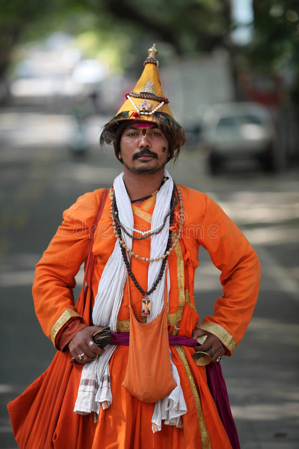 Vasudev. An Indian Vasudev, a type of Hindu pilgrims who are devotees of Lord Vishnu and wear a conical hat with peacock feathers. Vasudev has been a traditional