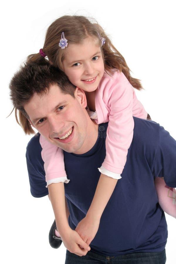 Vater-tragende Tochter lizenzfreies stockfoto