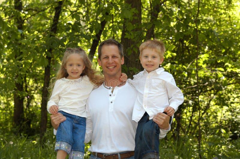 Vater und Kinder stockbild