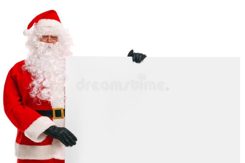 Vater-Weihnachten, das ein unbelegtes Zeichen anhält stockfoto