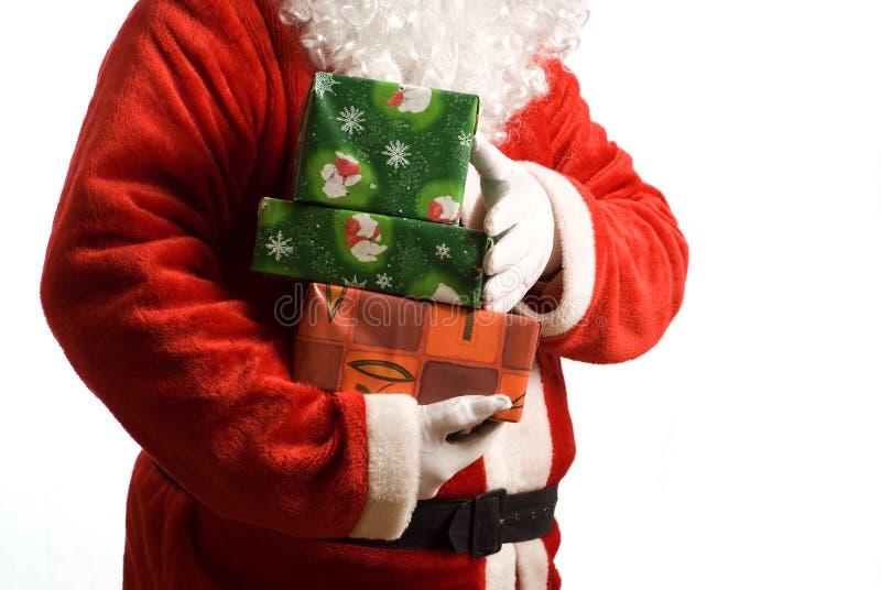 Vater-Weihnachten mit eingewickelten Geschenken stockbilder