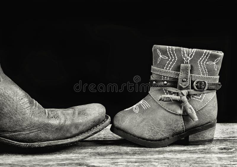 Vati-und Baby-Cowboy stockfoto
