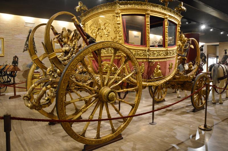VATICAN CITY - APRIL 5, 2016: Gilded carriage of the pope in the Vatican Museum, Rome, Italy stock image