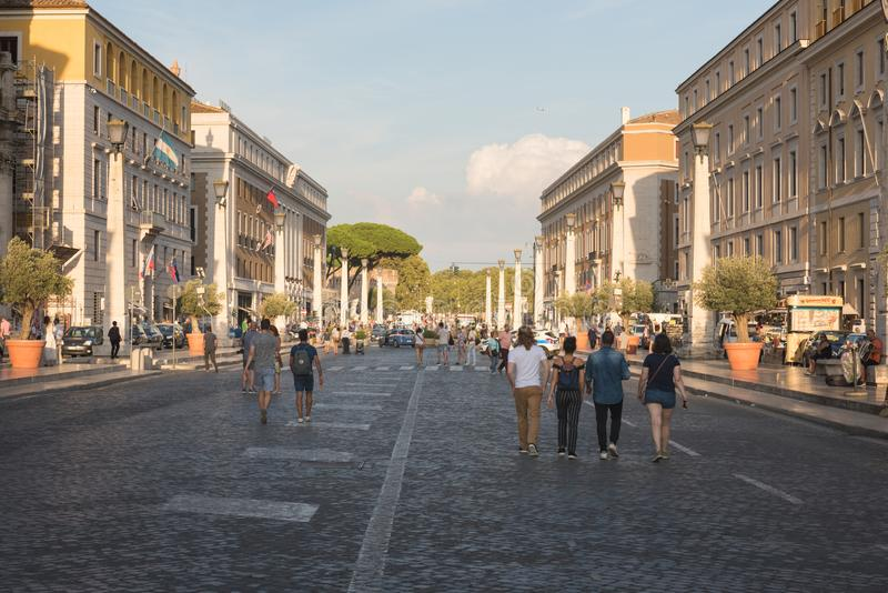 Crowds of tourists waliking near the Saint Peter`s Square in Vatican stock images