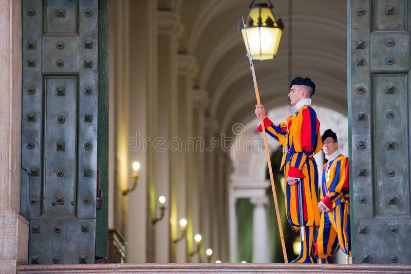VATICAN CITY, ITALY - MARCH 1, 2014 : A member of the Pontifical Swiss Guard, Vatican. VATICAN CITY, ITALY - MARCH 1, 2014 : A member of the Pontifical Swiss stock photo